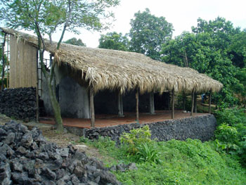 Classrooms at El Piscacho constructed from palm thatch, volcanic rock, rice straw bales and (inside) recycled tyres