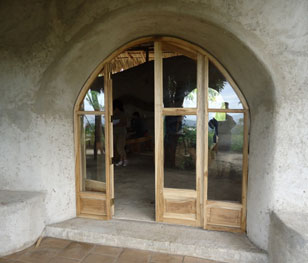 The entrance to the beautiful straw built dining and meeting area.